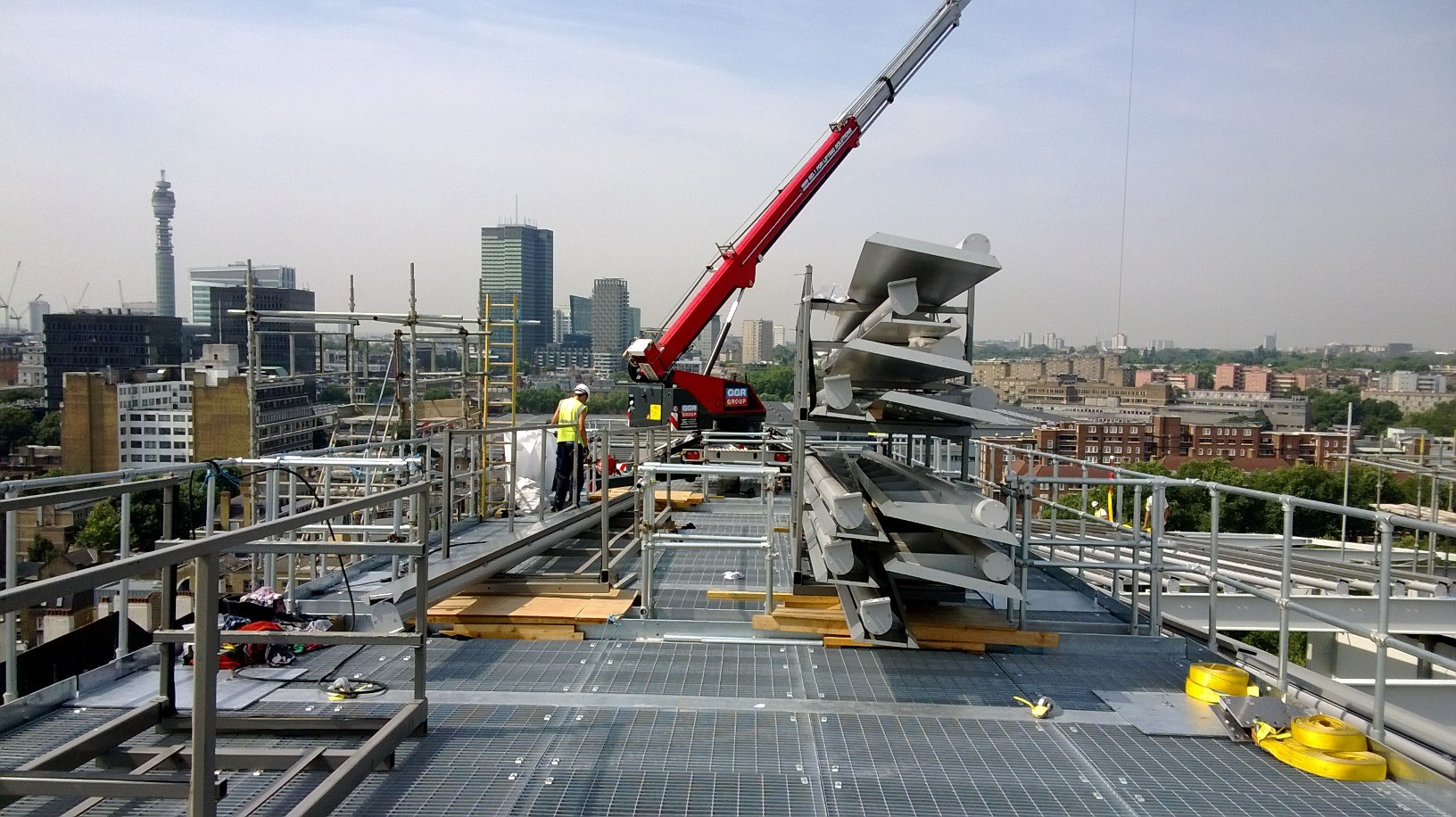 Crane base assembling louvres on the London skyline